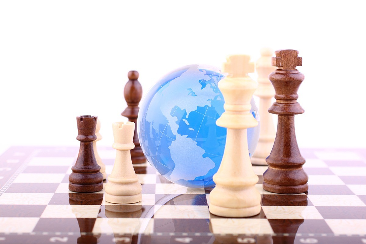 Medical Claims Management - Blue globe on chessboard